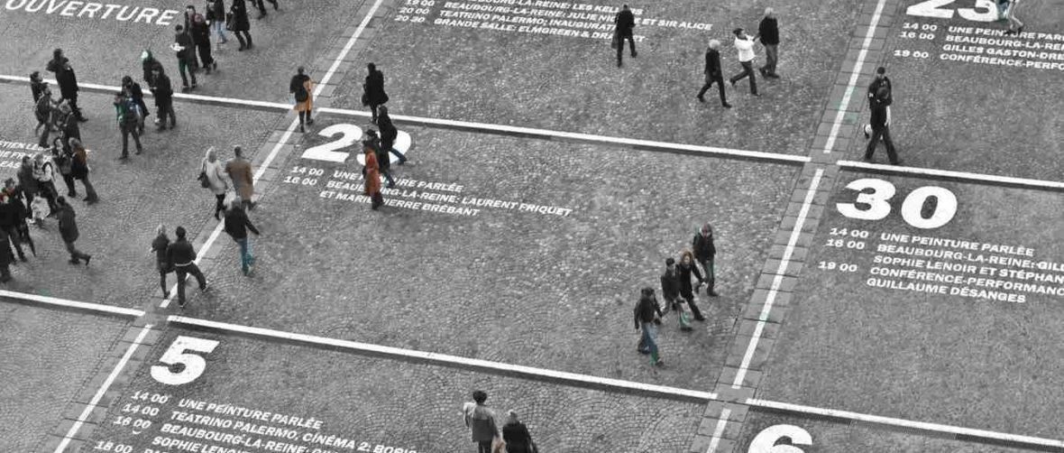 People Walking on Numbered Floor